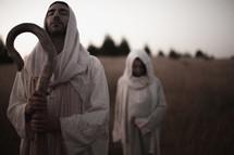 Joseph and Mary walking toward Bethlehem