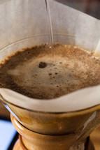 Coffee brewing in a chemex.