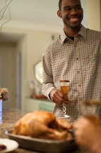 man toasting at a Thanksgiving table