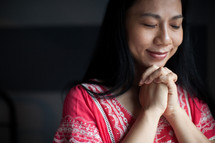 Asian woman with praying hands