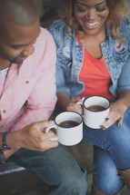 African American couple drinking coffee together
