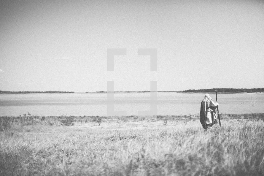 Paul walking through a field