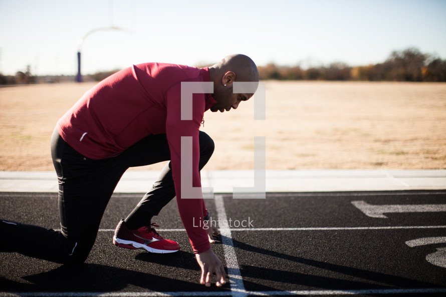 a man on a track about to run in a race