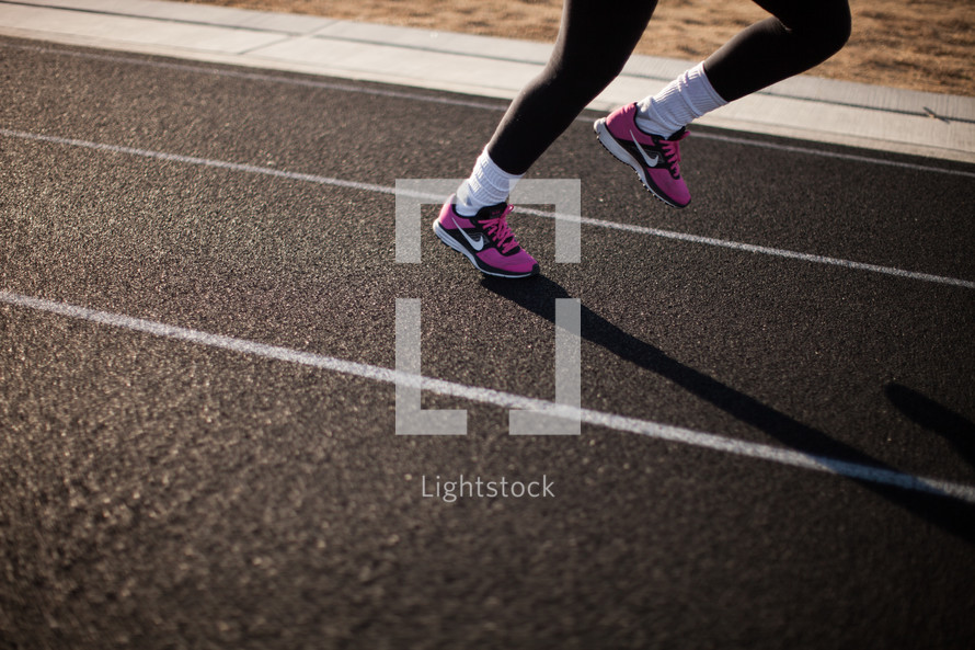 feet of a runner on a track