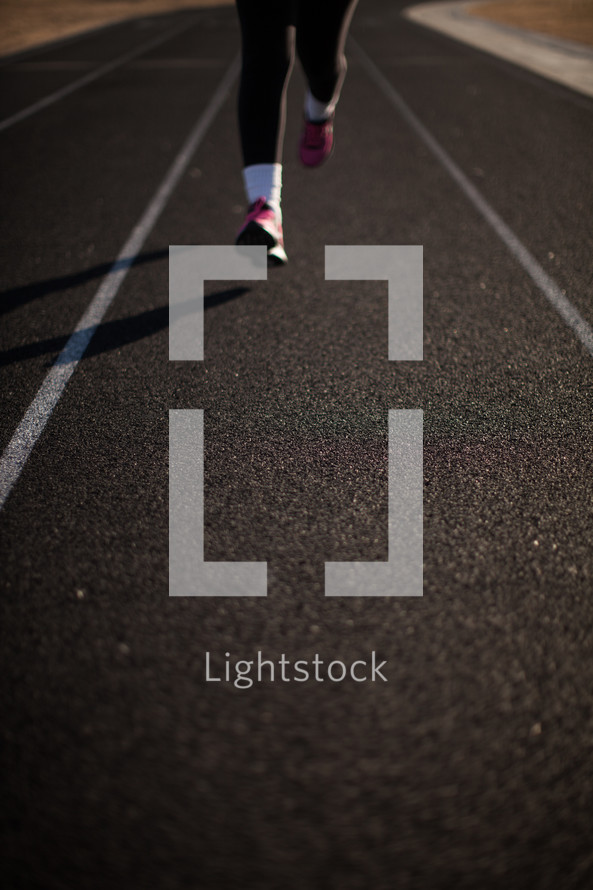 runner's feet on a track