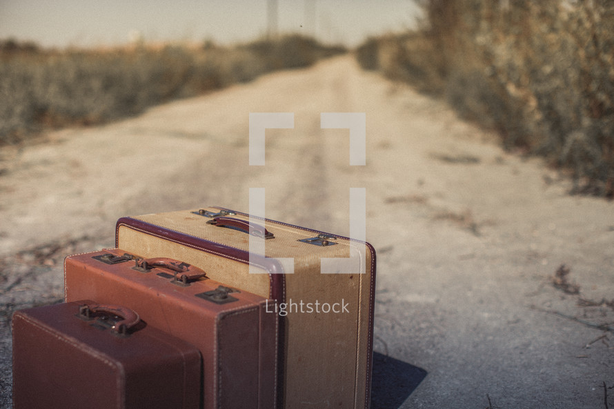 luggage on a dirt road