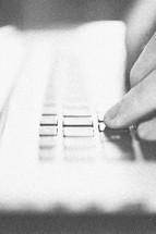 finger on a laptop keyboard