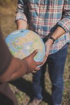 men holding a globe