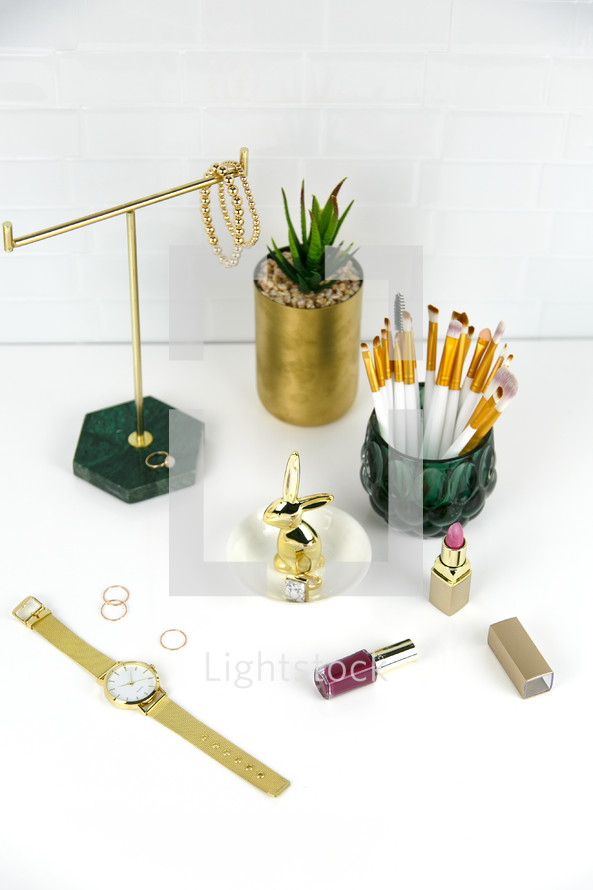 makeup and jewelry on a counter