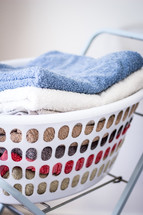 Stack of Towels in Washing Basket