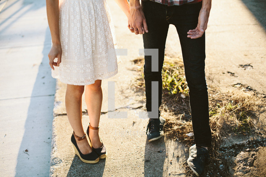 a couple standing on a sidewalk