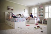 teens in a bedroom talking