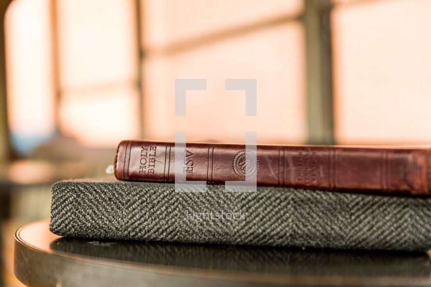 stack of books on an end table