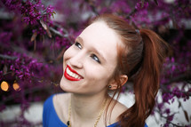 a teen red head posing for her senior portraits