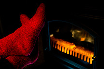 Close up of Stretching Feet in Red Socks by Fireplace