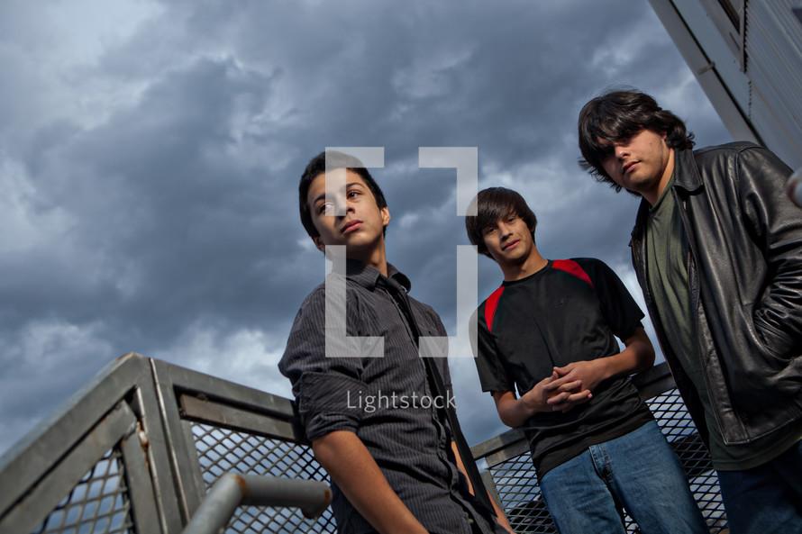 teen boys on bleacher stairs