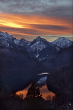 vibrant sky over snow covered mountain peaks at sunset