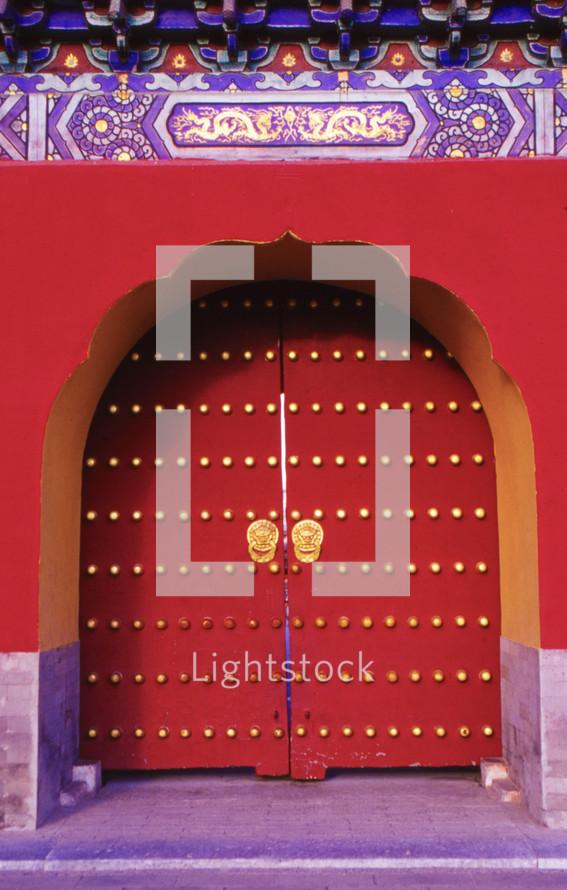 ornate red temple door