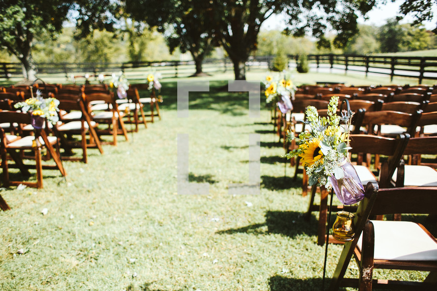 rows of chairs for an outdoor wedding