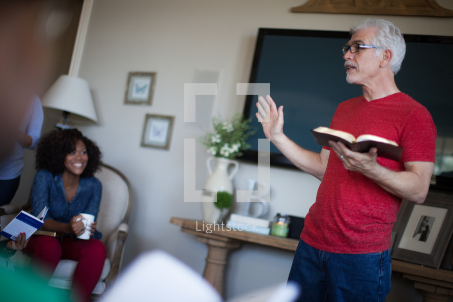 A man teaching a Bible study to a small group of people.