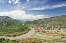 Mtkvari and Aragvi river through mountains and a village.