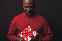 man opening a Christmas present