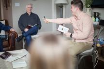 A man leading a Bible Study