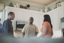 people in conversation in a kitchen at a small group Bible study