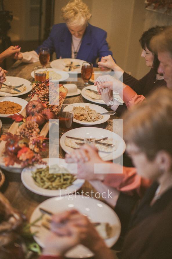 Family prayer at Thanksgiving.