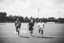 men running at a sports practice