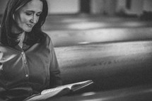 woman holding a hymnal