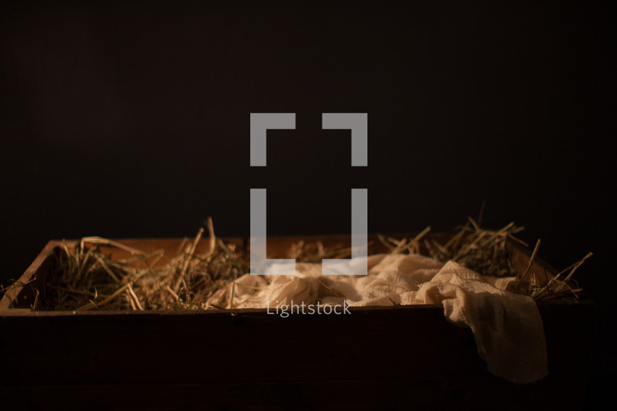 The manger filled with hay and swaddling clothes