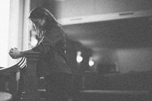 woman in prayer in a church