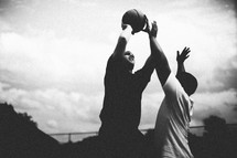 Men playing basketball.