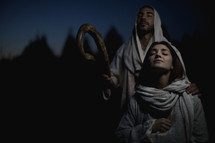 Joseph and Mary praying to God