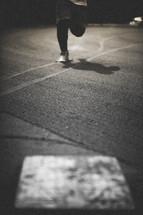 man running to a baseball base
