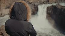 woman watching a waterfall