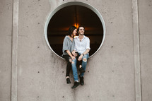 a couple sitting in a circular window
