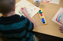 boy using water color paints