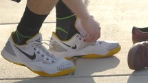 Putting On Basketball Shoes