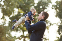 A Dad holding his Son in the air