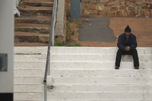 Man sitting on concrete steps