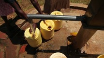 filling water jugs at a well