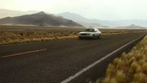 passing car on a desert road