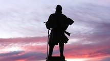 Denver statue at dusk