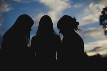 Silhouette of women praying