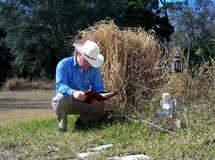 The sower of the good seed - a cowboy takes a break from his daily chores to reflect on the word of God and have a bible study in his quiet time away from work.