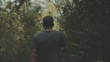 a man walking through a forest