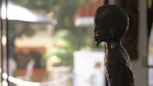 carved statue in Haiti