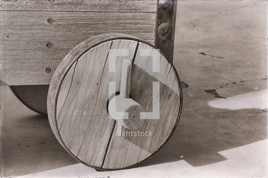 wooden wagon wheel on an old cannon